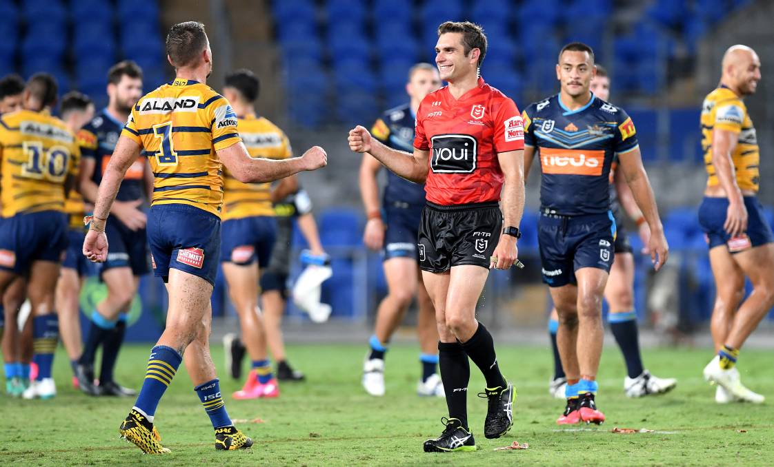 Clint Gutherson of the Eels fist pumps Referee Ziggy Przeklasa-Adamski after the round 2 NRL match between the Titans and Parramatta. Photo: Bradley Kanaris/Getty Images